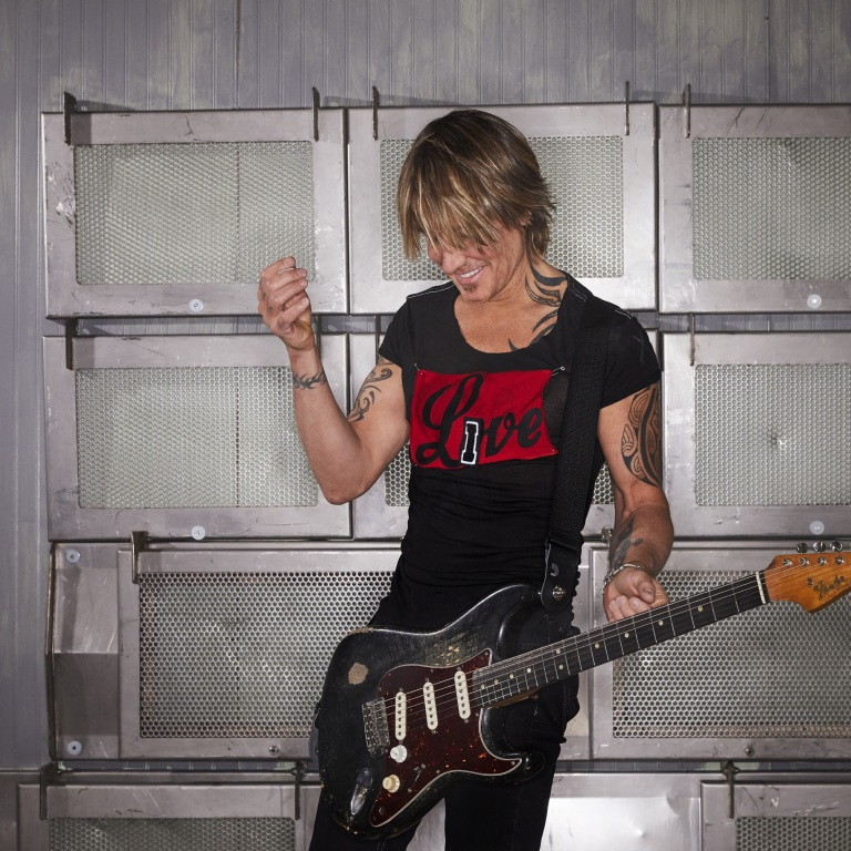 "KEITH URBAN PREMIERES NEW VIDEO FOR ""OUT THE CAGE"" FEATURING BRELAND, NILE RODGERS."