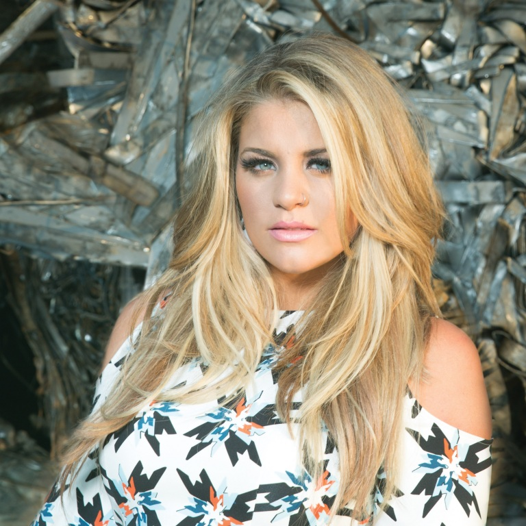 LAUREN ALAINA WRITES AND RECORDS EXCLUSIVE TRACK FOR ESPN'S COLLEGE FOOTBALL CAMPAIGN.
