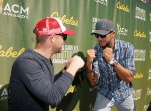 """LAS VEGAS, NEVADA - APRIL 02:  Singers Justin Moore (L) and Luke Bryan attend Cabela's & Academy of Country Music Celebrity Archery Tournament during the 4th ACM Party for a Cause Festival at at the Las Vegas Festival Grounds on April 2, 2016 in Las Vegas, Nevada.  (Photo by Isaac Brekken/Getty Images for ACM)"""