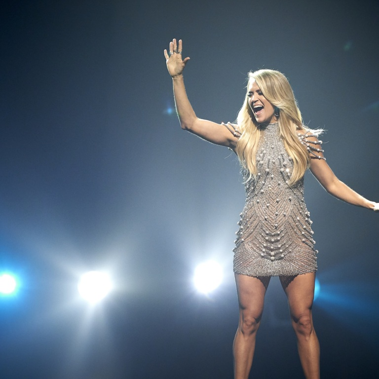 CARRIE UNDERWOOD RESEARCHES SPORTS SPEECHES FOR INSPIRATION FOR 'THE CHAMPION.'