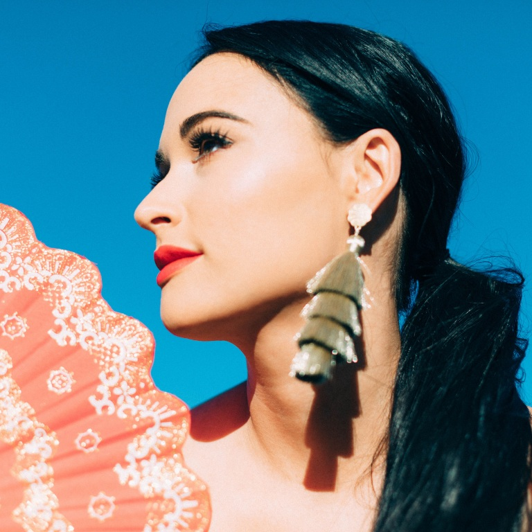 KACEY MUSGRAVES ANSWERS FAN QUESTIONS WHILE PLAYING WITH PUPPIES.