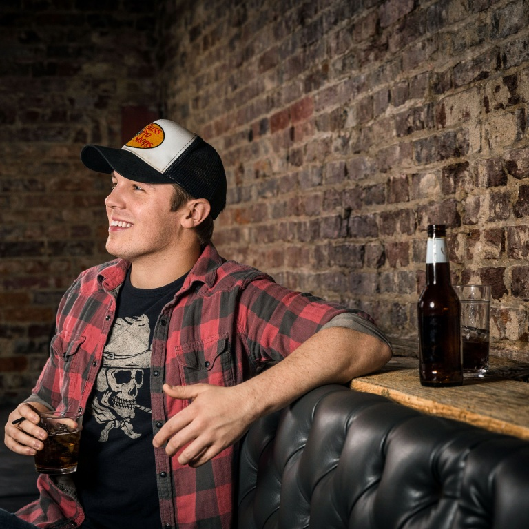 TRAVIS DENNING GETS SUPPORT FROM THE GRAND OLE OPRY AS ONE OF THE ORGANIZATION'S NEW NEXTSTAGE STARS.