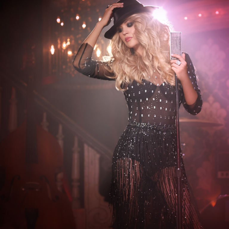 "CARRIE UNDERWOOD TAKES FANS BEHIND-THE-SCENES OF HER VIDEO FOR ""DRINKING ALONE."""